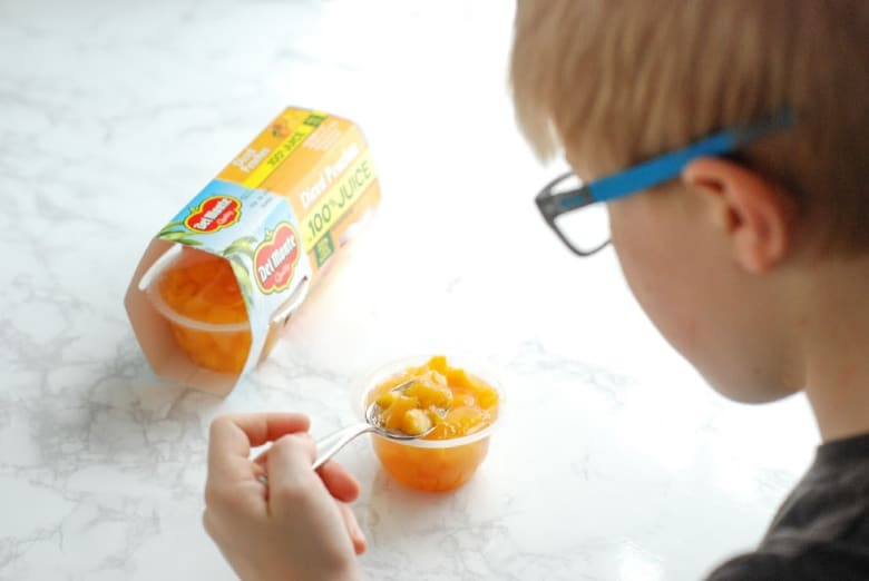 Child eating fruit cup